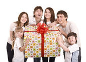 Happy family with gift box. — Photo