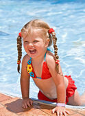 Child girl near blue swimming pool — Foto Stock