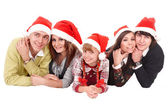 Happy family with child in santa hat. — Stock Photo