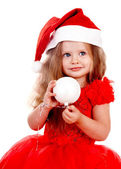 Child in santa hat with christmas ball — Stock Photo