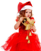 Child in santa hat with christmas bell. — Stock Photo