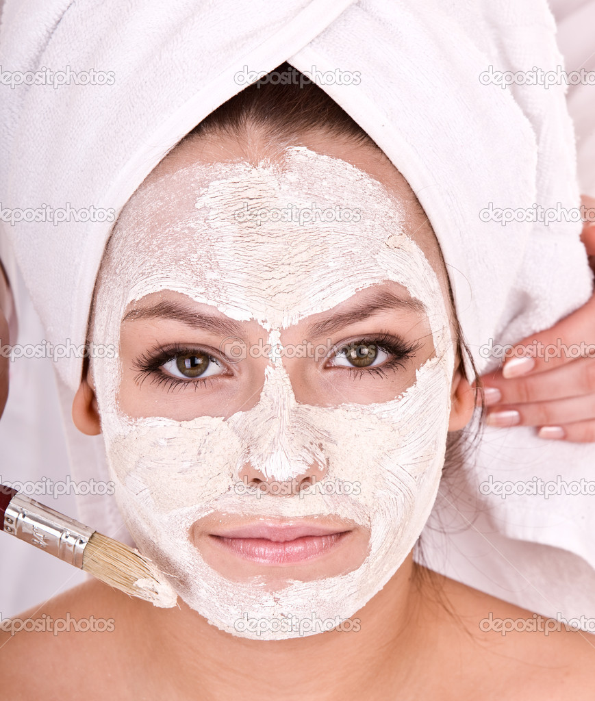 Cosmetician make  mask to  girl. Facial massage.  Stock Photo #1333883
