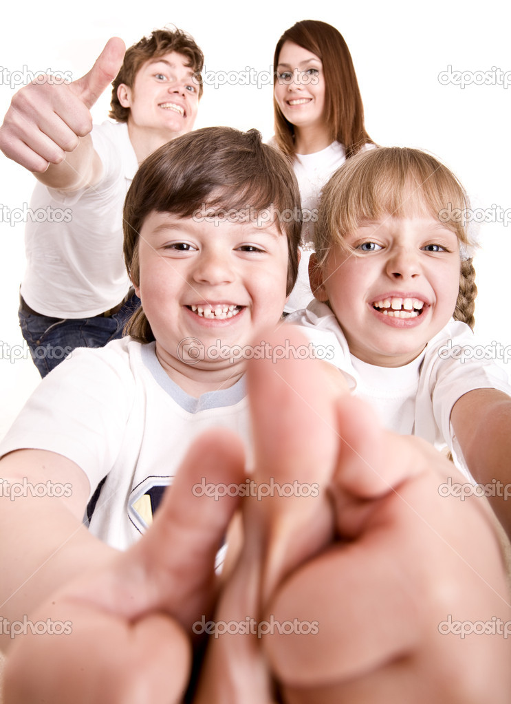 Happy family throw out thumb.Isolated. — Stock Photo #1336516