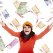 Girl in orange  hat  with flying money — Stock Photo