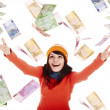 Girl in orange  hat  with flying money - Stock Photo