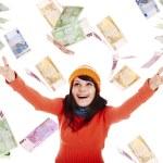flicka i orange hatt med flygande pengar — Stockfoto