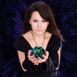 Girl with fortune telling ball — Stock Photo