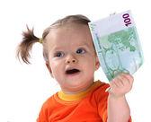 Baby taking euro. — Stock Photo