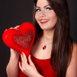 Girl with red heart on grey background — Stock Photo #1859151
