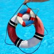 Group of life buoy on water. — Stock Photo