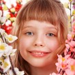 Stock Photo: Child girl on spring flower.