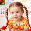 Foto Stock: Child with chalk draw in playroom.