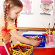 Royalty-Free Stock Photo: Child with colour pencil in play room.
