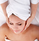 Young woman in spa. Facial massage. — Stock Photo