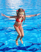 Girl with goggles jumping. — Stock Photo
