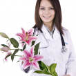 Stock Photo: Doctor with stethoscope and flower.