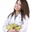 Doctor with green apples. — Stock Photo