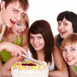 Group of teenagers with cake — Stock Photo