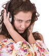 Girl in summer dress listen music. - Foto Stock