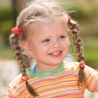 Cute child with long hair. Nature. — Stock Photo