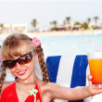 Child girl in sunglasses and red bikini — Stock Photo #2285224