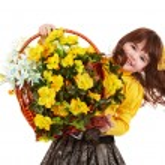 Beautiful girl with wild yellow flower. — Stock Photo #2285594