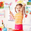 Child with picture and brush — Stock Photo #2285813