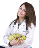 Doctor with green apples. — Stok fotoğraf