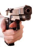 Big gun in female hand. — Stock Photo