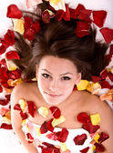 Beautiful girl in rose petal. — Stock Photo