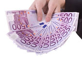 Money euro in girl hand. — Stock Photo