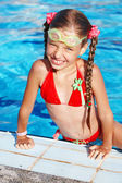 Girl with goggles and red swimsuit. — Stock Photo