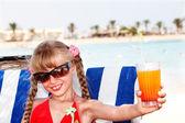 Child girl in sunglasses and red bikini — Stock Photo
