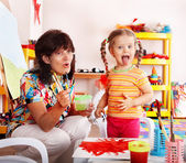 Child with teacher draw paints — Stock Photo