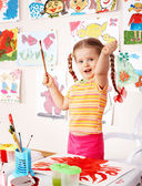 Child with picture and brush — Stock Photo