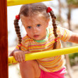 Child girl on ladder in playground. - Stock Photo