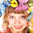 Girl with butterfly and flower — Stock Photo #2302906