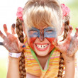 Child girl with paint on face. — Stock Photo