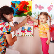 Child with teacher draw paints — Stock Photo #2304453
