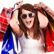 Girl in white glasses with shopping bag — Stock Photo #2306027