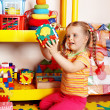 Child with puzzle and block in playroom — Stock Photo