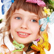 Beautiful girl with butterfly and flower — Stock Photo
