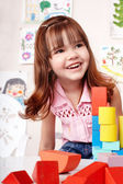 Child with block and construction — Stock Photo