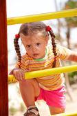 Child girl on ladder in playground. — Stock Photo