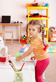 Child with paint and brush — Stock Photo