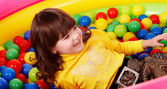 Girl with ball in play room. — Stock Photo