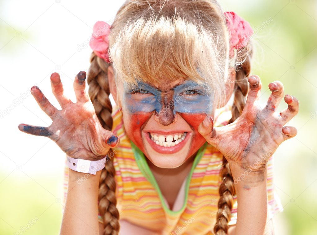 Child girl with paint on face and hand. — Stock Photo #2304198