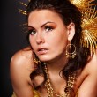 Young woman with gold feather — Stock Photo