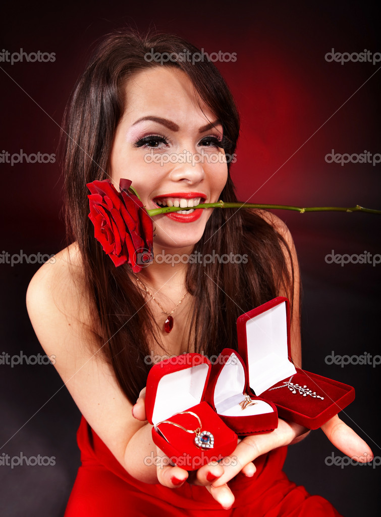Girl with group jewellery gift box and rose on red  background.   Valentines day. — Stock Photo #2336718