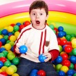 Happy birthday of little boy in balls. — Stockfoto